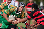 Daniel Lottering eyes up Papakura's Kelly Maka  as he takes the ball up from a ruck. Counties Manukau Premier Club Rugby Game of the Week between Drury & Papakura, played at Drury Domain on Saturday Aprill 11th, 2009..Drury won 35 - 3 after leading 15 - 5 at halftime.