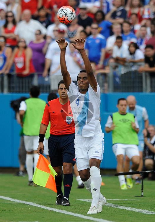 Guatemala defender Wilson Lalin (4) takes a throw-in during the first half. Guatemala played the USA Men's National Team in an International Friendly soccer game on Friday July 3, 2015 at Nissan Stadium in Nashville, Tennessee. The USA won, 4-0.