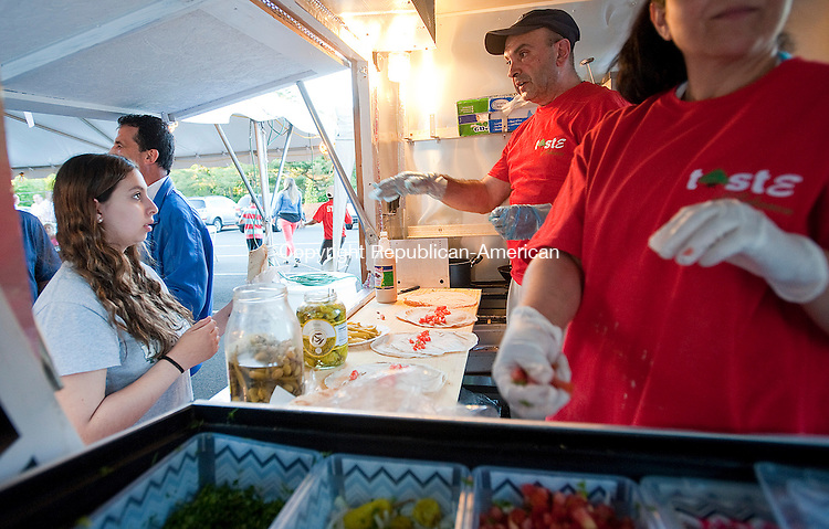 WATERBURY, CT-060614JS19--Ruba Khazzaka of Watertown, left, orders a shawarma from Elis Taweh during opening night of the annual Taste of Lebanon at the Our Lady of Lebanon Maronite Church on East Mountain Road in Waterbury. Then three-day event runs Saturday from 12 p.m. to 12 a.m. and Sunday from 10 a.m. to 5 p.m.<br /> Jim Shannon Republican-American