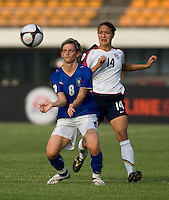 USWNT defender (14) Stephanie Cox stays close to Italy's (8) Melania Gabbiadini during the last group stage game at the Peace Queen Cup.  The USWNT defeated Italy, 2-0, at the Suwon Sports Center in Suwon, South Korea.