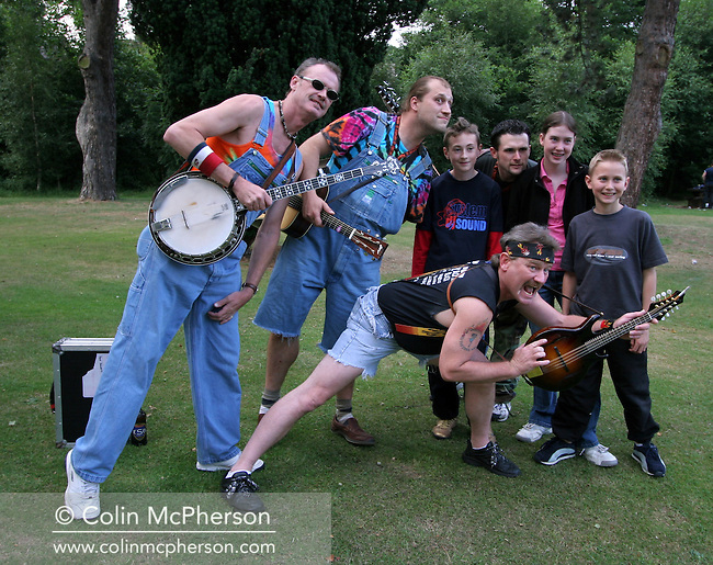 American Bluegrass band Hayseed Dixie and fans, pictured before playing the Newton Music Festival, where they headlined. The band members are: Barley Scotch (vocals, acoustic guitar and violin), Don Wayne Reno (banjo), Dale Reno (mandolin) and Jason D. Smith (bass).