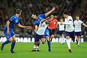 27th March 2018, Wembley Stadium, London, England; International Football Friendly, England versus Italy; Marco Parolo of Italy brings down Raheem Sterling of England