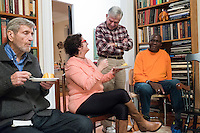 "Former Massachusetts governor Michael Dukakis (center, standing, speaks with Barrie Baker (left center seated) and her husband Jimmie Baker, Jr., of Waltham, Mass., after a meeting of a support group for people who have had electroconvulsive therapy (ECT) led by Dukakis and his wife Kitty Dukakis in their home in Brookline, Massachusetts, USA, on Sun., Dec. 4, 2016. Kitty Dukakis used ECT to treat depression and substance abuse issues. She continues to have ECT treatments about once every seven or eight weeks. It was the Bakers' first time attending the support group. A family practitioner, Barrie Baker said during the meeting that ""ECT saved my life twice."""
