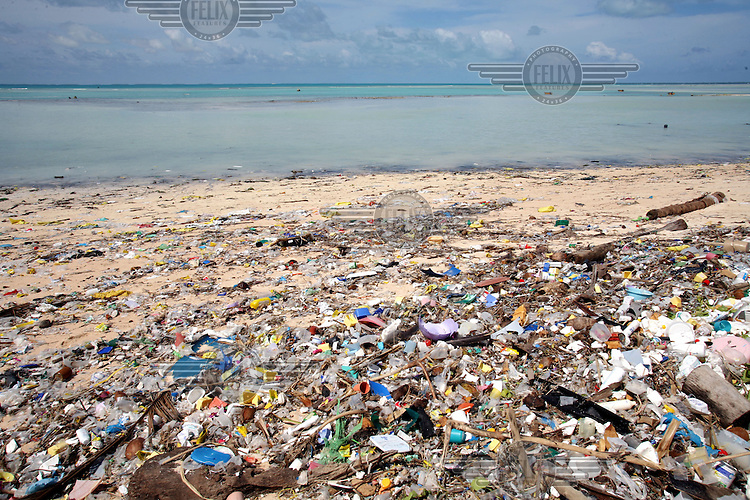 Garbage on a beach in Tarawa. The rapidly increasing urban population are facing serious health and environmental problems in South Tarawa. With over 36,700 people living on the island of 15.76 sq km, the population density exceeds 2,300 persons per sq. km.