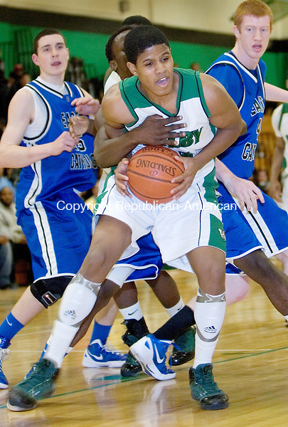 WATERBURY, CT. 07 March 2012-030712SV06-#34 Ezekiel Canady of Wilby gets wrapped up by #20 Marques Wiafe of East Catholic during the second round of the CIAC Class L basketball tournament at Wilby High in Waterbury Wednesday..Steven Valenti Republican-American