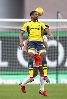 Blackpool's Kelvin Mellor jumps with  Oxford United's Dwight Tiendalli,<br /> <br /> Photographer Mick Walker/CameraSport<br /> <br /> The EFL Sky Bet League One - Oxford United v Blackpool - Saturday 6th January 2018 - Kassam Stadium - Oxford<br /> <br /> World Copyright &copy; 2018 CameraSport. All rights reserved. 43 Linden Ave. Countesthorpe. Leicester. England. LE8 5PG - Tel: +44 (0) 116 277 4147 - admin@camerasport.com - www.camerasport.com
