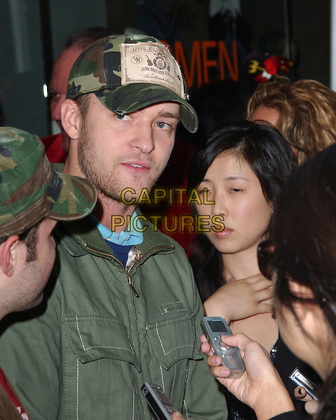 JUSTIN TIMBERLAKE.The William Rast Collection L.A. Debut at Kitson in Los Angeles, California  .November 10th, 2005.Ref: DVS.headshot portrait baseball cap hat stubble facial hair .www.capitalpictures.com.sales@capitalpictures.com.Supplied By Capital PIctures