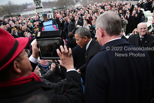 United States President Barack Obama arrives during the presidential inauguration on the West Front of the U.S. Capitol January 21, 2013 in Washington, DC.   Barack Obama was re-elected for a second term as President of the United States.   U.S. Senator Lamar Alexander (Republican of Tennessee) is at far right.    .Credit: Win McNamee / Pool via CNP