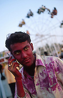 "S?dasien Asien Indien IND Bombay Mumbai .indisches Fruehlingsfest Holi , Menschen bespruehen bespritzen bewerfen sich mit Farbe Farbpuder , junger Mann mit Reliance Mobiltelefon am Juhu Beach -  Fest Feste Festival Inder indisch xagndaz | .South Asia India Bombay Mumbai .indian spring festival Holi , people throw color and powder  -  man with mobile phone at Juhu Beach .| [ copyright (c) Joerg Boethling / agenda , Veroeffentlichung nur gegen Honorar und Belegexemplar an / publication only with royalties and copy to:  agenda PG   Rothestr. 66   Germany D-22765 Hamburg   ph. ++49 40 391 907 14   e-mail: boethling@agenda-fototext.de   www.agenda-fototext.de   Bank: Hamburger Sparkasse  BLZ 200 505 50  Kto. 1281 120 178   IBAN: DE96 2005 0550 1281 1201 78   BIC: ""HASPDEHH"" ,  WEITERE MOTIVE ZU DIESEM THEMA SIND VORHANDEN!! MORE PICTURES ON THIS SUBJECT AVAILABLE!! INDIA PHOTO ARCHIVE: http://www.visualindia.net ] [#0,26,121#]"