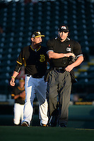 Bradenton Marauders manager Michael Ryan (12) argues a call with umpire Kirk Struble during a game against the Charlotte Stone Crabs on April 22, 2015 at McKechnie Field in Bradenton, Florida.  Bradenton defeated Charlotte 7-6.  (Mike Janes/Four Seam Images)