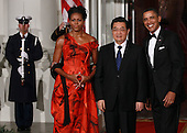 United States President Barack Obama (R) and first lady Michelle Obama (L) welcome President Hu Jintao of China (C) for a State dinner at the White House, Wednesday, January 19, 2011 in Washington, DC. Obama and Hu met in the Oval Office earlier in the day.  .Credit: Win McNamee / Pool via CNP