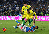 BOGOTA -COLOMBIA, 7-06-2017. Andres Cadavid player of Millonarios fights the ball  agaisnt of  Andres Uribe player of Atletico Nacional .Action game between  Millonarios  and Atletico Nacional during match for semifinals of the Aguila League I 2017 played at Nemesio Camacho El Campin stadium . Photo:VizzorImage / Felipe Caicedo  / Staff