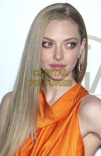 Amanda Seyfried.At the 24th Annual Producers Guild Awards held at the Beverly Hilton Hotel, Beverly Hills, California, USA,.26th January 2013..PGAs PGA arrivals headshot portrait cowl neck   dangling earrings orange  sleeveless  .CAP/ADM/RE.©Russ Elliot/AdMedia/Capital Pictures.