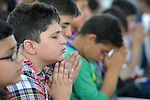 Children prepare for first communion in a Catholic church in a displaced persons camp in Ankawa, near Erbil, Iraq.