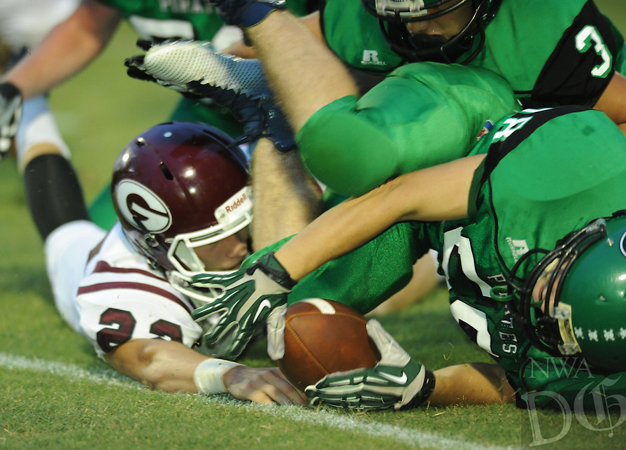 NWA Democrat-Gazette/ANDY SHUPE<br /> Trey Burnette (right) of Greenland recovers a fumble in front of Bryan Harris (left) of Gentry Friday, Sept. 18, 2015, during the first half of play at Jonathan Ramey Memorial Stadium in Greenland. Visit nwadg.com/photos to see more photographs from the game.