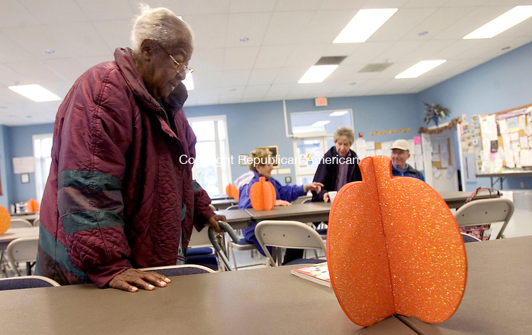 WOLCOTT, CT. 29 October 2012-102912SV02-Gloria Williams of Wolcott gets ready to leave the senior center in Wolcott Monday. The senior center was open as a warming center until the town opens their shelter at Tyrrell Middle School on Todd Road. .Steven Valenti Republican-American