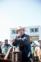 E.B. Harris auctions off old farm equipment at the Lions Club Seabord Auction in North Carolina.