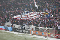 USA fans hold up scarves and an American flag during the national anthem at Dick's Sporting Good Park in Commerce City, CO before the USA Men's National Team's World Cup Qualifier against Costa Rica on March 22, 2013.