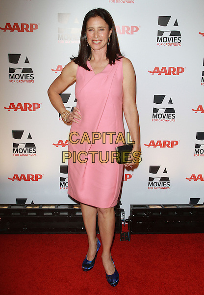 MIMI ROGERS .AARP The Magazine's 10th Annual Movies For Grownups Awards held At The Beverly Wilshire Hotel, Hollywood, California, USA..February 7th, 2011.full length black clutch bag pink sleeveless dress blue silk satin shoes hand on hip.CAP/ADM/KB.©Kevan Brooks/AdMedia/Capital Pictures.