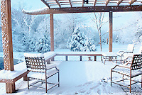 Deck with snow on burniture