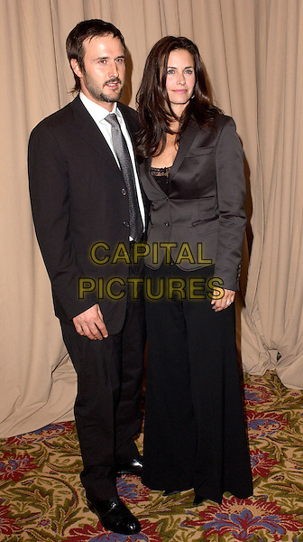 DAVID ARQUETTE & COURTENEY COX ARQUETTE.The Saks Fifth Avenue's Unforgettable Evening honouring Lance Armstrong by Entertainment Industry Foundation's Women's Cancer Fund held at The Regent Beverly Wiltshire in Beverly Hills, California  .March 1st, 2005.full length celebrity couple married husband wife black suit black trousers grey gray jacket courtney.www.capitalpictures.com.sales@capitalpictures.com.Supplied By Capital PIctures