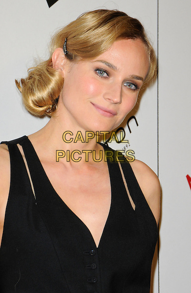 DIANE KRUGER .arriving at the 4th Annual Hamilton Behind The Camera Awards at The Highlands in Hollywood, California, USA, November 8th 2009. .portrait headshot black cut out straps cleavage hair clip grip waistcoat.CAP/ROT.©Lee Roth/Capital Pictures