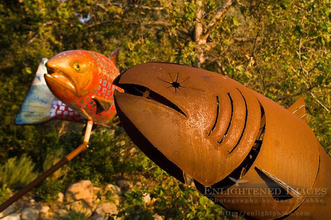 Metal art sculptures of native american motif salmon El Capitan Canyon Resort, near Santa Barbara, California