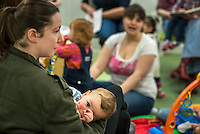 Mother breastfeeding her baby at a drop-in breastfeeding support centre.