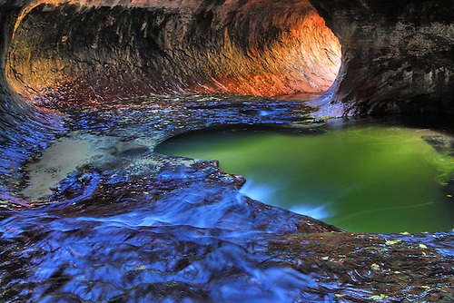 "Water flows from the Left Fork of North Creek through the pools at ""The Subway"" during autumn at Zion National Park"