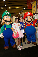 Visitors to Hyper Japan 2014, Earls Court, London, UK, July 25, 2014. Hyper Japan is the UK's largest Japanese culture event. It took place at the Earls Court exhibition space from 25 to 27 July 2014.