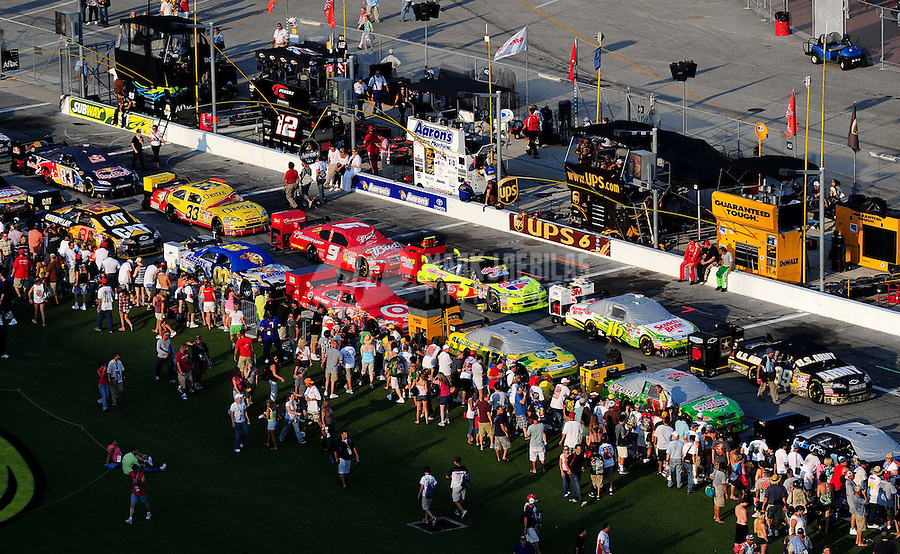 Jul. 4, 2009; Daytona Beach, FL, USA; NASCAR Sprint Cup Series fans surround the starting field of cars as they sit on pit road prior to the Coke Zero 400 at Daytona International Speedway. Mandatory Credit: Mark J. Rebilas-
