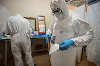 Health care workers in the ELWA II ETU (Ebola treatment unit), Monrovia, Liberia on Friday, March 6, 2015. <br /> Occidental College professor Mary Beth Heffernan's PPE Portrait Project involves creating wearable portraits of the health care workers who must wear PPE (personal protective equipment) when working with patients.<br /> (Photo by Marc Campos, Occidental College Photographer) Mary Beth Heffernan, professor of art and art history at Occidental College, works in Monrovia the capital of Liberia, Africa in 2015. Professor Heffernan was there to work on her PPE (personal protective equipment) Portrait Project, which helps health care workers and patients fighting the Ebola virus disease in West Africa.<br />