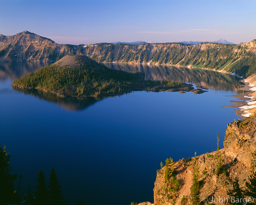 ORCL_037 - USA, Oregon, Crater Lake National Park, Sunrise light on Wizard Island, view south from Merriam Point with Mount Shasta and Mount McLoughlin visible in the distance.