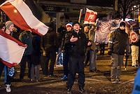 Ca. 90 Hooligans und Nazis beteiligten sich am Montag den 1. Februar 2016 im Berliner Stadtteil Prenzlauer Berg an einer NPD-Demonstration gegen Asyl und Fluechtlinge. Die aggressive Demonstration wurde von lautstarken Protesten mehrerer hundert Gegendemonstranten begleitet. Die Demonstrationsroute wurde auf Anweisung der Polizei um 2/3 gekuerzt.<br /> Im Bild: Ein Demonstrationsteilnehmer beschipft Gegendemonstranten.<br /> 1.2.2016, Berlin<br /> Copyright: Christian-Ditsch.de<br /> [Inhaltsveraendernde Manipulation des Fotos nur nach ausdruecklicher Genehmigung des Fotografen. Vereinbarungen ueber Abtretung von Persoenlichkeitsrechten/Model Release der abgebildeten Person/Personen liegen nicht vor. NO MODEL RELEASE! Nur fuer Redaktionelle Zwecke. Don't publish without copyright Christian-Ditsch.de, Veroeffentlichung nur mit Fotografennennung, sowie gegen Honorar, MwSt. und Beleg. Konto: I N G - D i B a, IBAN DE58500105175400192269, BIC INGDDEFFXXX, Kontakt: post@christian-ditsch.de<br /> Bei der Bearbeitung der Dateiinformationen darf die Urheberkennzeichnung in den EXIF- und  IPTC-Daten nicht entfernt werden, diese sind in digitalen Medien nach §95c UrhG rechtlich geschuetzt. Der Urhebervermerk wird gemaess §13 UrhG verlangt.]