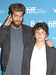 Andrew Garfield and Noah Lomax during the Photo Call for '99 Homes' at the the tiff Bell Lightbox during the 2014 Toronto International Film Festival on September 9, 2014 in Toronto, Canada.