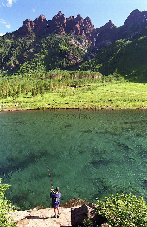 Fishing at Maroon Lake in the White River National Forest, near the Maroon Bells. Aspen, Colorado. © Michael Brands. 970-379-1885.