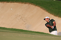 Patrick Reed (USA) out of the 18th green side bunker during the final round of the DP World Tour Championship, Jumeirah Golf Estates, Dubai, United Arab Emirates. 18/11/2018<br /> Picture: Golffile | Fran Caffrey<br /> <br /> <br /> All photo usage must carry mandatory copyright credit (© Golffile | Fran Caffrey)