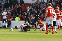 Referee Jeremy Simpson (C) awards a foul to George Byers of Swansea City (L) by Joe Lolley of Nottingham Forest  during the Sky Bet Championship match between Nottingham Forest and Swansea City at City Ground, Nottingham, England, UK. Saturday 30 March 2019