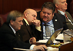 Nevada Assembly members, from left, John Ellison, R-Elko, Ira Hansen, R-Sparks, and Richard Carillo, D-Las Vegas, work in committee at the Legislative Building in Carson City, Nev., on Tuesday, Feb. 12, 2013..Photo by Cathleen Allison