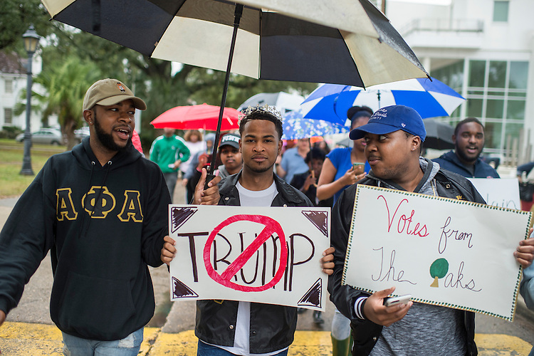 UNITED STATES - NOVEMBER 08: Darren Scioneaux, center, and other Dillard University students march to their polling place on campus to vote in New Orleans, La., November 8, 2016. Caroline Fayard, Democratic candidate for the U.S. Senate from Louisiana, walked with the students. (Photo By Tom Williams/CQ Roll Call)