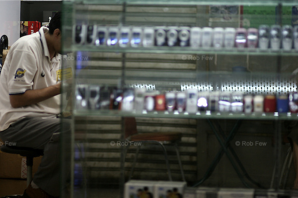 Phones for sale in Chungking Mansion. The primary customers are Africans buying them in batches of about 50 for resale in the exploding African mobile markets.