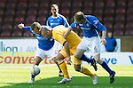 Motherwell v St Johnstone....28.04.12   SPL.Michael Higdon is closed down by Jody Morris and Steven Anderson.Picture by Graeme Hart..Copyright Perthshire Picture Agency.Tel: 01738 623350  Mobile: 07990 594431
