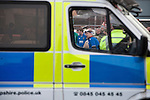 "Portsmouth 1 Southampton 1, 18/12/2012. Fratton Park, Championship. A group of Portsmouth fans peering through a line of police officers in a street outside Fratton Park stadium before their club take on local rivals Southampton in a Championship fixture. Around 3000 away fans were taken directly to the game in a fleet of buses in a police operation known as the ""coach bubble"" to avoid the possibility of disorder between rival fans. The match ended in a one-all draw watched by a near capacity crowd of 19,879. Photo by Colin McPherson."