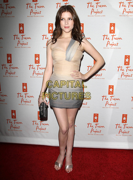 ANNA KENDRICK .Trevor Live Benefiting The Trevor Project held At The Hollywood Palladium, Hollywood, CA, USA,.5th December 2010..full length  one shoulder strap beige grey gray cream ombre dress ruched silver open toe sandals clutch bag .CAP/ADM/KB.©Kevan Brooks/AdMedia/Capital Pictures.