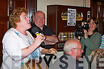 CAUGHT ON CAMERA: Sinead Barry, one of the F.A.S filmmakers making a documentary about the regeneration of the John Mitchell's GAA club, captures Anne O'Connor on film, as she reminisces about the good old days at the celebration night held in the Clubhouse on Thursday night.   Copyright Kerry's Eye 2008