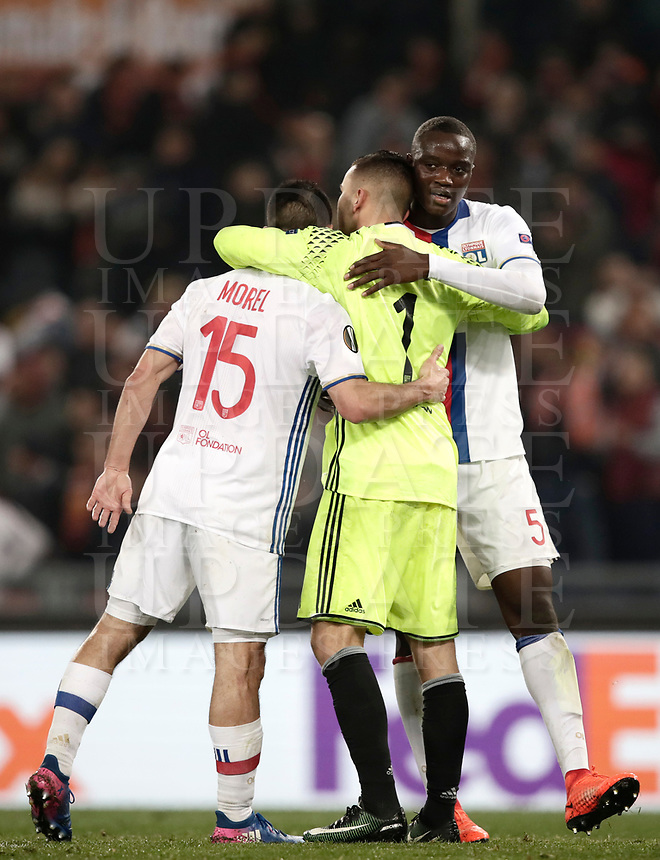Football Soccer: Europa League Round of 16 second leg, Roma-Lyon, stadio Olimpico, Roma, Italy, March 16,  2017. <br /> Lyon's Jérémy Morel (l), Anthony Lopes (c) and Mounter Diakhaby (r) celebrate at the end of the Europe League football soccer match between Roma and Lyon at the Olympique stadium, March 16,  2017. <br /> Despite losing 2-1, Lyon reach the quarter finals for 5-4 aggregate win.<br /> UPDATE IMAGES PRESS/Isabella Bonotto