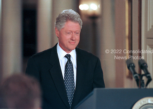 United States President Bill Clinton steps to the podium in to begin a formal press conference in the East Room of the White House on July 21, 1999.<br /> Credit: Ron Sachs / CNP