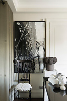 In the living room, the monochrome design enhances the small space.  Contemporary retro ceramics and artworks, all chosen for their small scale, gives the interior an extra edge.