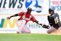 Nashville Sounds second baseman Irving Falu (19) takes a throw as Paulo Orlando (16) slides into second during a game against the Omaha Storm Chasers on May 20, 2014 at Herschel Greer Stadium in Nashville, Tennessee.  Omaha defeated Nashville 4-1.  (Mike Janes/Four Seam Images)
