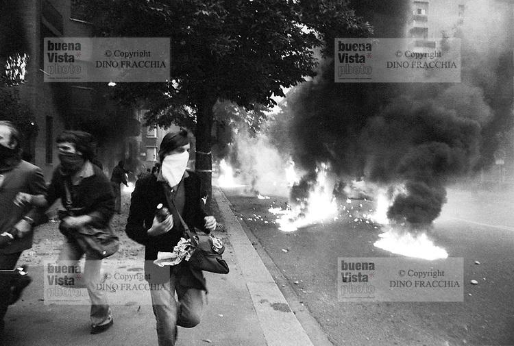 - young people of radical associations assault the Spanish consulate after a demonstration against  Francisco Franco dictator (Milan, 1975)<br /> <br /> - giovani appartenenti ad organizzazioni di sinistra assaltano il consolato spagnolo dopo una manifestazione contro il dittatore Francisco Franco (Milano, 1975)